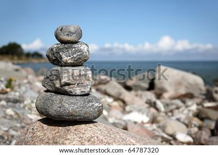 Cairn on beach - stock photo