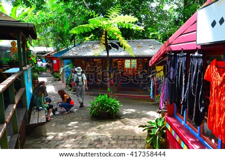 CAIRNS, AUS - APR 16 2016:Shoppers at the Original Rainforest  Market a popular travel destination in Kuranda at the Atherton Tableland tropical north of Queensland, Australia