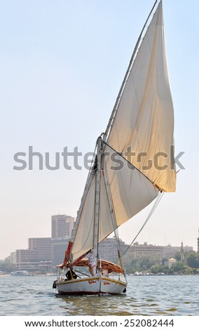 CAIRO - CIRCA JUNE 2014: Arab woman with her husband in a scarf on a yacht sailing on the Nile in Egypt. - stock photo