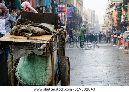 Cairo, December 12th, 2015. A trolley in front of an Egyptian cleaner who's doing his work in the morning before Cairo's biggest bazaar Khan el-Khalili gets crowded.
