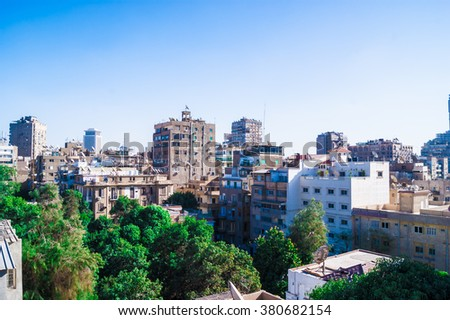 Cairo (Egypt) city view photo,beautiful view on the capital with green tress and palms, traditional house and buildings, polluted town air