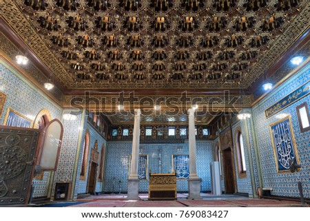 Cairo, Egypt - December 2, 2017: Interior of public mosque of Manial Palace of Prince Mohammed Ali Tewfik with wooden golden ornate ceilings, Cairo, Egypt