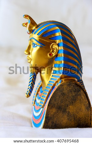 CAIRO EGYPT - DECEMBER MAY 19 2009: A copy of Tutankhamun's mask at the Tutankhamun exhibition. These copies are for sale.  - stock photo