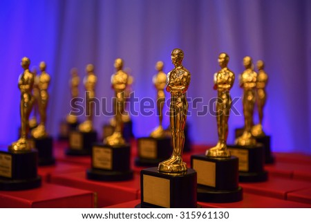 CAIRO, EGYPT - December 9, 2014: Replica of the Academy Award Trophies being sold in local bazaar  - stock photo
