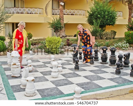 Cairo, Egypt. May 25, 2013. Two women play in the big chess. A game. Editorial photo.