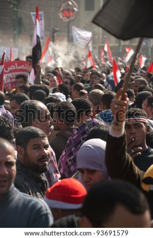 CAIRO – JAN 25: Thousands of Egyptians gather in Tahrir Square some to celebrate the success of Islamist parties while others calling for further political reforms in Cairo, Egypt on January 25, 2012 - stock photo