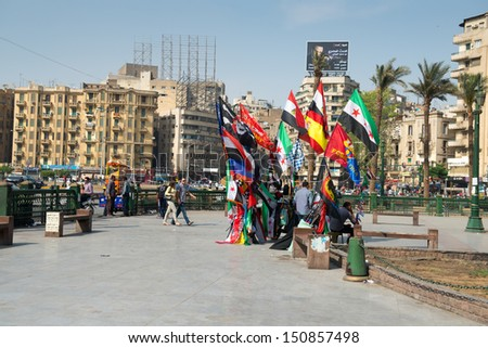 CAIRO - MAY 8: The famous Tahrir square on May 8, 2013 in Cairo, Egypt. Tahrir square - place there thousands of protesters made Egyptians uprising in January 2011. - stock photo