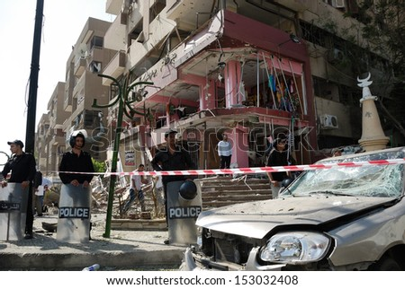 CAIRO - SEP 05: Remains of a big local store at Mostafa Nahas st and neighbors cars after explosion that was targeting the convoy of the Egypt's Interior Minister in Cairo, Egypt on September 05, 2013 - stock photo
