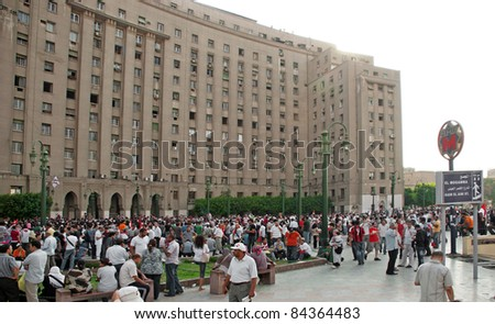 """CAIRO - SEPTEMBER 9: Crowds of Egyptians converged by Tahrir building on Friday to demand reforms in a turnout dubbed """"correcting the path of the revolution"""".  Cairo, September 9, 2011 - stock photo"""