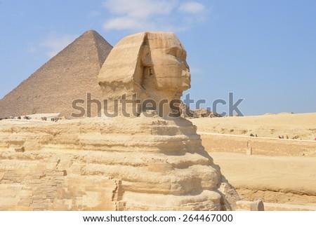 Cairo - Sphinx and Pyramid at Giza, Egypt - stock photo