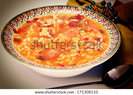Cajun Chicken and Sausage Gumbo in a bowl with spoon and napkin. - stock photo