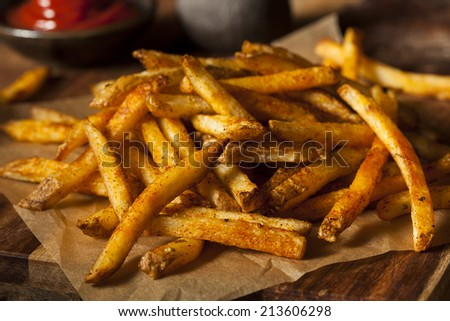Cajun Seasoned French Fries with Organic Ketchup - stock photo