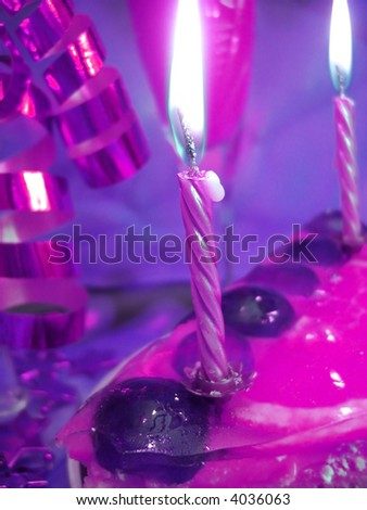 cake and candles on violet color