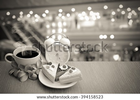 cake and coffee with blur bokeh and escalator in shopping mall background