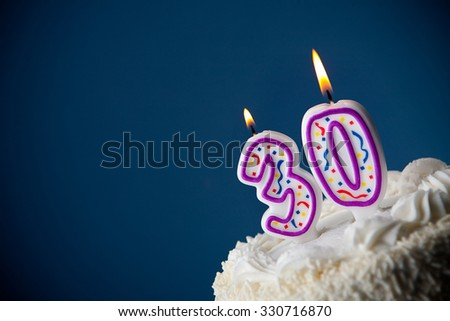 Cake: Birthday Cake With Candles For 30th Birthday - stock photo