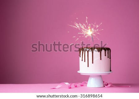 Cake decorated with a sparkler - stock photo