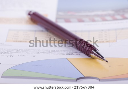 Cake diagram with pen pointing, statistics concept - stock photo