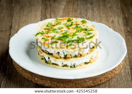 Cake from thin pancake crepes, layers of chicken, sour cream, rustic dish on shrovetide - stock photo