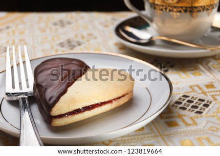 Cake heart with jam and chocolate for Valentine-day - stock photo