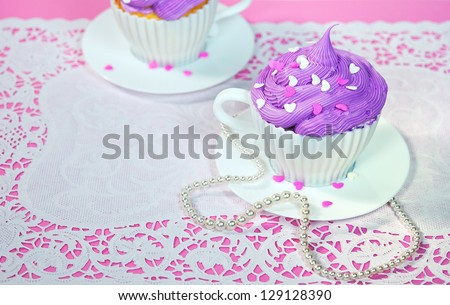 cake in a teacup with string of pearls - stock photo