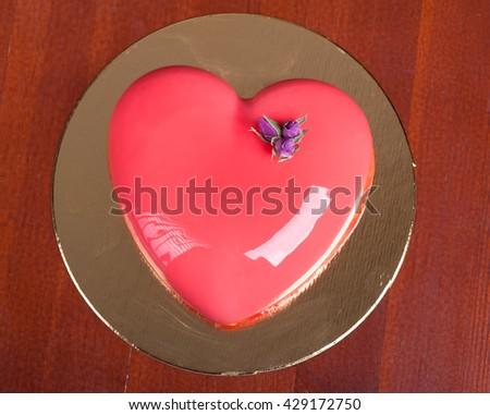 Cake in shape of heart - stock photo