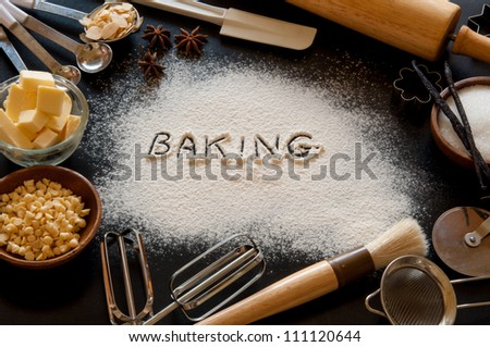 Cake ingredients and kitchen utensil. - stock photo