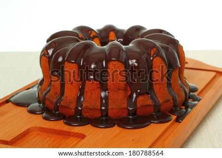 Cake is ready. Bundt cake with chocolate glaze. - stock photo
