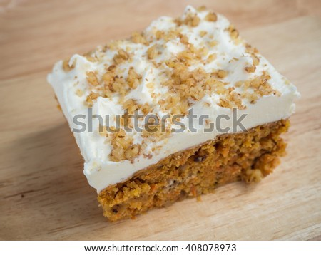 cake made from carrot and topping with cream cheese and walnut