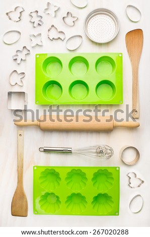 cake mould and tools for muffin, Cupcake and cookie bake  on white wooden background, top view - stock photo