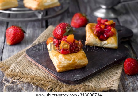 Cake of puff pastry with strawberry , tomato and meet, isolated  - stock photo