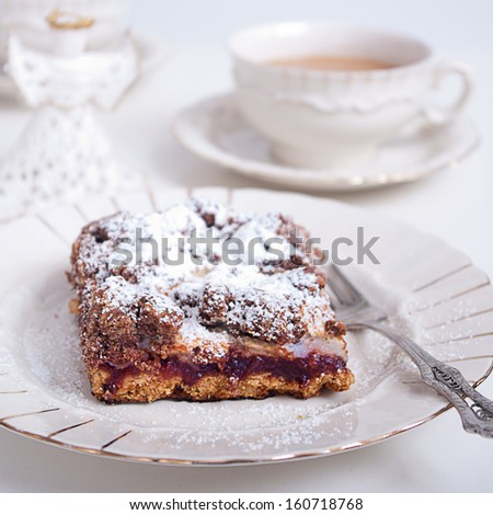 Cake on a plate and coffee.