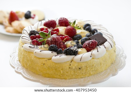 cake pastry decorated with fresh fruits and cream - stock photo