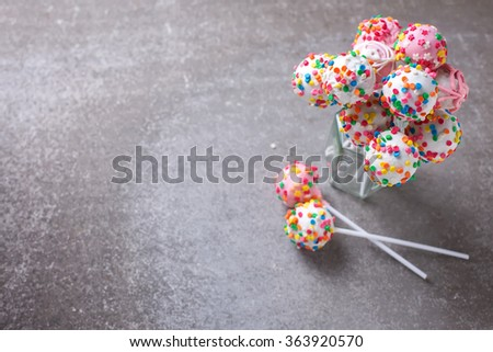 Cake pops can on grey slate background. Selective focus. Place for text. - stock photo