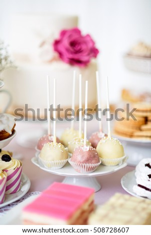 Cake pops on cakestand and various cakes . Candy bar.