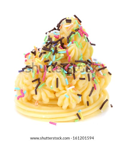 Cake topped with sprinkles. Isolated on a white background. - stock photo