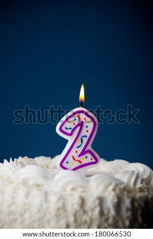 Cake: White Iced Birthday Cake With Candles For 2nd Birthday - stock photo