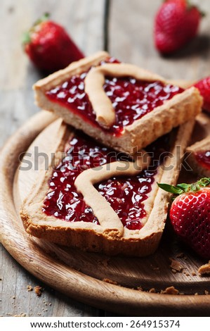 Cake wit strawberry on the wooden table, selective focus - stock photo