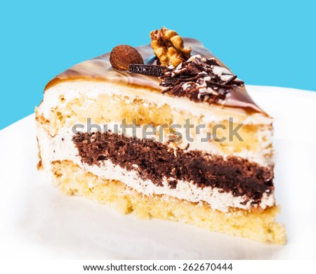 cake with a chocolate interlayer on a blue background