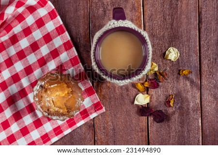 Cake with a cup on the table. Cup of coffee with milk and a delicious cupcake on a wooden table. Cozy atmosphere. Light breakfast on the table - stock photo