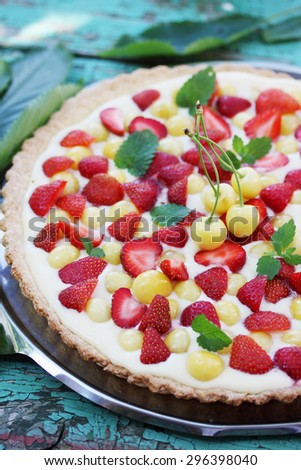 cake with a shortcrust pastry, custard fruit cherries and strawberries - stock photo