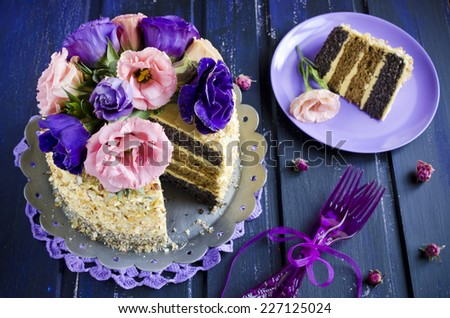 cake with almonds and poppy seeds on a dark wood background
