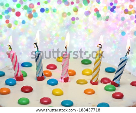 Cake With Burning Candles,  five multi-colored candles. Background with colorful lights. - stock photo