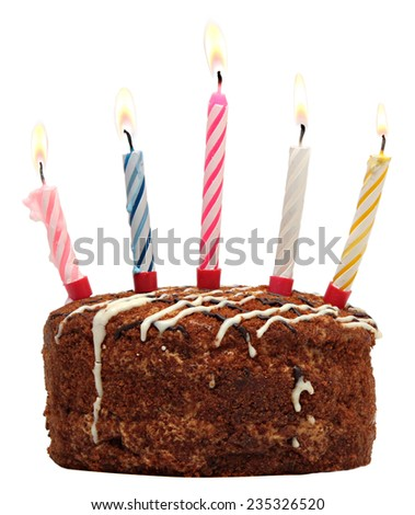 Cake with burning candles isolated on white background.