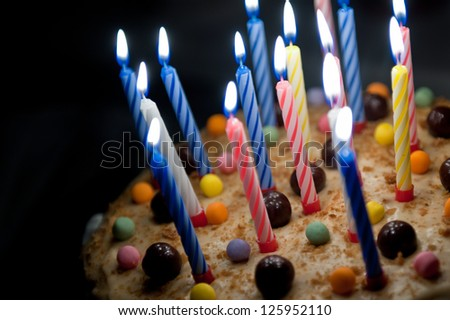 Cake with candles - stock photo