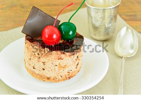 Cake with Cherries and Chocolate, Cupcake on Wood Background. Studio Photo.
