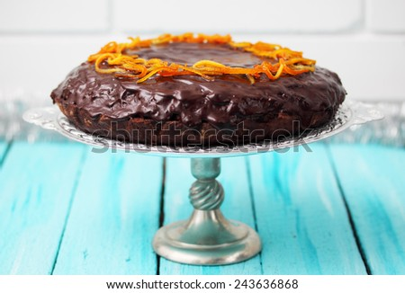 cake with chocolate icing with candied orange peel - stock photo