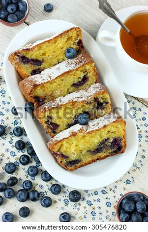 Cake with cottage cheese and blueberries on a white table - stock photo