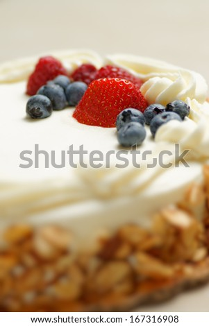 Cake with cream and berries - stock photo