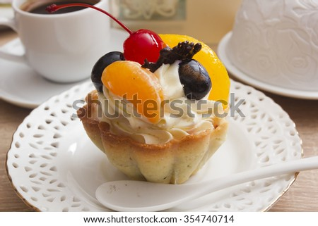 Cake with cream and cherries in a basket made of dough. - stock photo