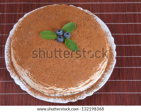 cake with cream and cocoa powder, close up, top view - stock photo
